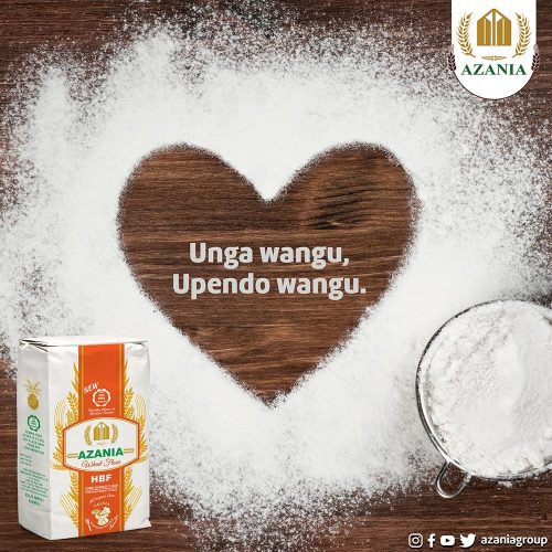 Heart shape of flour on brown wooden board background